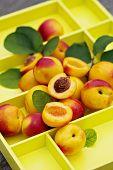 Fresh nectarines on yellow tray