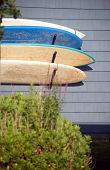 stock photo of trailer park  - surfboards hanging on house trailer wall in surf park Montauk New York United States - JPG