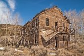 picture of neglect  - Old hotel in a Montana ghost town is losing its balcony and roof to time and neglect - JPG