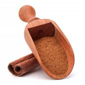 ground cinnamon spice powder in wooden spoon isolated on white background cutout