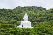 Big white Buddha on mountain