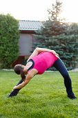 Flexible Woman Doing Exercises Outdoor