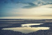 Conceptual Landscape Image Of Two People On Remote Beach With Instagram Style Filter