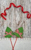Two Green Fir Tree With Ribbon On The Old Wood Background