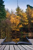 Beautiful Vibrant Autumn Woodland Reflecions In Calm Lake Waters Landscape Conceptual Book Image
