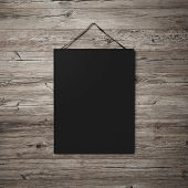 Black Blank Poster Hanging On Leather Belt On Wood Background