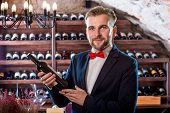 foto of wine cellar  - Sommelier with wine bottle in the wine cellar - JPG