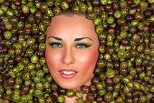Beautiful female face in gooseberry