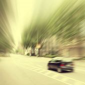 Motion blurred image of a city street scene.Vintage style.