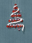 Christmas Tree Made of Ornaments on Blue Textured Background