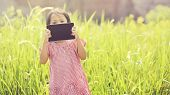 Happy Girl Playing Outdoor With Tablet