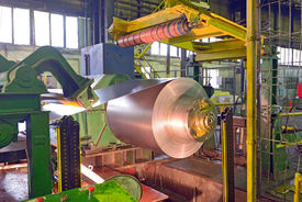 stock photo of coil  - steel coil processing machine inside of steel plant - JPG