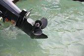 image of outboard  - Motor boat is small craft equipped with an outboard motor but can be used oars - JPG