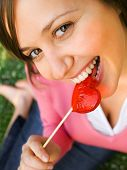 stock photo of lollipops  - Woman with a heart - JPG