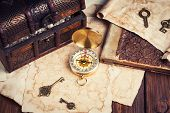 pic of treasure chest  - treasure chest compass and old map on wooden table - JPG