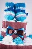 pic of diaper  - cake made from diapers on white background - JPG