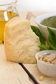 stock photo of pesto sauce  - Italian traditional basil pesto sauce ingredients on a rustic table - JPG