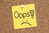 stock photo of oops  - Oops note paper pinned on cork bulletin board - JPG