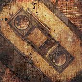 pic of magnetic tape  - audio cassette with magnetic tape on grunge background - JPG