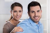 image of family planning  - Young married couple in the office making plans for retirement and future - JPG