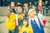 stock photo of shogun  - happy asian family in asakusa temple - JPG