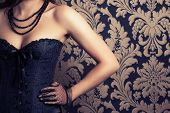 pic of corset  - woman wearing black corset and pearls against retro background - JPG
