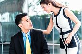 picture of sexuality  - Asian business woman sexually harassing man in public  - JPG