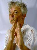 Dirty Senior Man Showing a Karate Move
