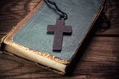 picture of christianity  - Closeup of wooden Christian cross on bible - JPG
