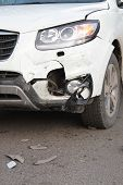 stock photo of headlight  - White car with smashed bumper and broken headlight - JPG