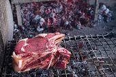 pic of porterhouse steak  - Heavy slice of meat named fiorentina steak ready for grill - JPG
