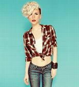 stock photo of country girl  - Fashionable blonde girl on blue background - JPG