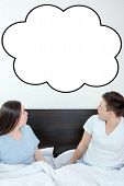 foto of bubble sheet  - Handsome man and pretty surprised woman in bedroom looking up at thinking speech bubble comic cloud or empty copyspace - JPG