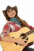 stock photo of cowgirls  - a cowgirl leaning back and laughing while she plays her guitar - JPG