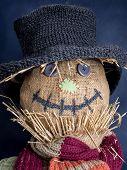 stock photo of scarecrow  - Closeup of scarecrow head on dark blue background - JPG