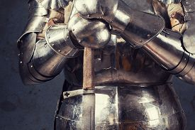 image of sword  - knight wearing armor and standing with two - JPG