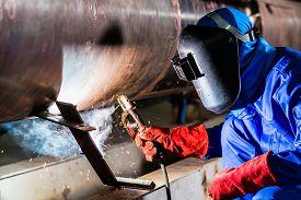 picture of pipe-welding  - Welder in factory welding metal pipes - JPG