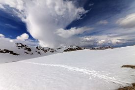 stock photo of plateau  - Snowy mountains and sky with clouds - JPG