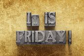 foto of friday  - it is Friday exclamation made from metallic letterpress type on vintage cardboard - JPG