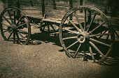 picture of wagon wheel  - Old wagon wheel symbolic of American Wild West Cowboy concept - JPG