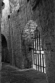 stock photo of dungeon  - Interior of a prison inside the citadel in Hvar Croatia - JPG