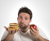 foto of junk  - Man undecided between diet and junk food - JPG