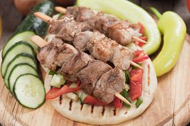 picture of souvlaki  - Souvlaki or kebab with vegetable salad on pita bread - JPG