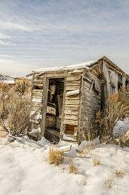 picture of outhouse  - This dilapidated outhouse would not be standing if it weren - JPG