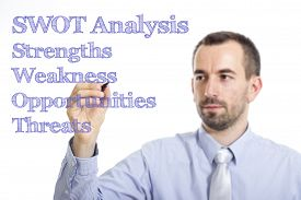 foto of swot analysis  - SWOT Analysis Young businessman writing blue text on transparent surface - JPG
