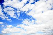 White fluffy clouds in blue sky. poster