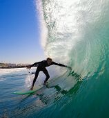 Surfer Ducking into Tube