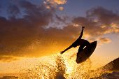 Surfer Does an Air at Sunset