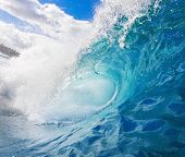 A Large Blue Wave Crashes onto the Reef in Tropical Ocean, Perfect Surfing