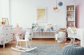 Bright Baby Room With White Furniture, Grey Carpet On The Floor And Golden Painting On The Empty Wal poster